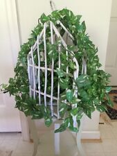 White Wicker Birdhouse With Greenery And Lights