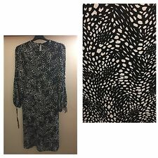 BLACK WITH WHITE PATTERN ALL OVER..SIZE 10..CALF LENGTH..BRAND NEW..TUNIC STYLE