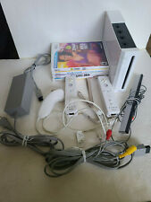 Wii Game System with Controllers and 4 Games Lot