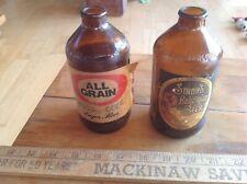 New Listing2 Vintage Beer Bottles 12 oz Brown All Grain & Strohs paper labels Display Bar
