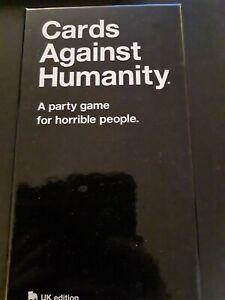 Cards against humanity UK Edition + Erweiterungen + Koffer