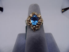ladies oval blue topaz &  diamonds ring 14kt yellow gold