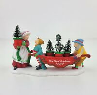 Dept 56 North Pole Accessory Delivering The Christmas Greens Mrs. Claus Figurine