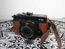 Fujifilm X-e2 (black) with 18mm f/2 lens and fujifilm leather half-case