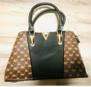 Black and brown small handbag with matching mini bag