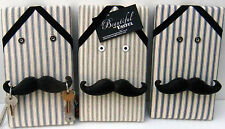 Moustache key hanger on blue ticking fabric covered memo board