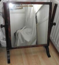 A 19th century rectangular framed swing mahogany toilet mirror