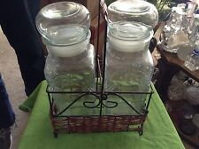 Glass containers in a wire and wicker basket