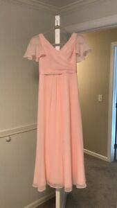 Junior bridesmaid dress size 10. Beautiful pink chiffon with flutter sleeves.