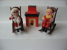 Vtg plastic miniature Santa & Mrs Claus sitting in rocking chair next fireplace