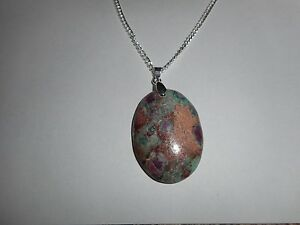 Ruby in fushite oval pendant on silver chain necklace