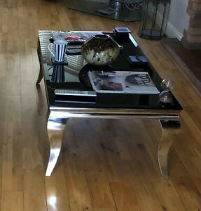 Coffee Table Chrome legs and base with black tempered glass top.