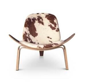 Starker Kuhfell Loungesessel auf echtem Wallnuss Holz Dreibeinig Qualität