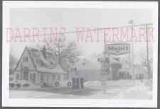 Vintage Snapshot Photo Roadside Mobil Gas Service Station in Winter Snow 686603