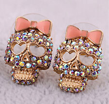 Goth retro style gold tone crystal skull with pink bow stud earrings