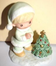 Estate=Little Boy Dressed in Green praying to the cross on top of Christmas Tree