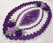 purple and white crocheted oval roses doily  by Aeshagirl