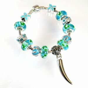 Aqua Marine and Green Bead Charm Bracelet with Dog Tooth Ashes Charm