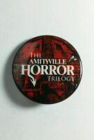 "THE AMITYVILLE HORROR TRILOGY COMIC CON SWAG MOVIE SM 1.5"" PINBACK BUTTON PIN"