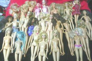 Lot of 25 Barbie Dolls