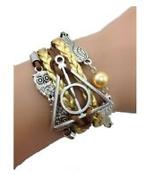 Bracelet Harry Potter marron et or Relique De La Mort, hiboux et vif d'or