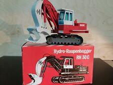 Ketten Bagger O&K RH 30 C Tri Power  NZG  1:50  OVP