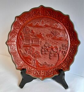 Fine vintage Chinese Cinnabar lacquer plate with pagodas in landscape.