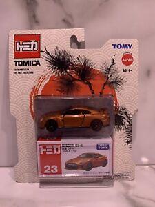 Tomica Tomy Nissan GT-R #23 In Orange .