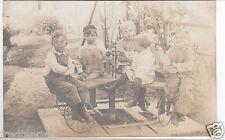 RPPC - Children riding Home-made Merry-Go-Round - 1908