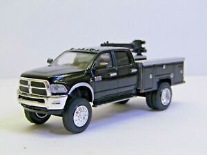 dcp/greenlight dually Custom lifted black Ram 3500 service truck no box 1/64.