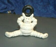 MICHELIN TIRE MAN FIGURE SITTING HOLDING TIRE ABOVE HEAD Cast Iron Paperweight
