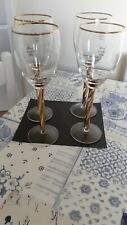4 TALL WINE GLASSES WITH GOLD TWISTED STEMS AND GOLD TRIM