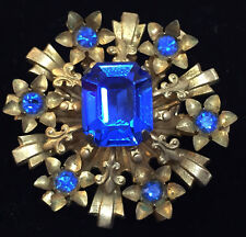 Coro Blue Rhinestone Brooch Pin Brass Fleur de Lis Flower Floral Early Vintage
