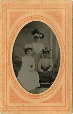 1/4 PLATE ANTIQUE TINTYPE PHOTO OF THREE BEAUTIFUL YOUNG WOMEN REARING HATS