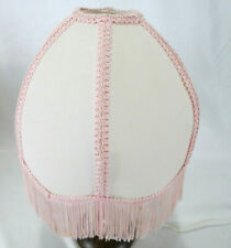 Pink Dome Shaped Lamp Shade With Fringe And A Scalloped Edge