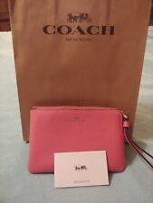 Coach wristlet new with tags/Pink
