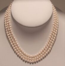 Hand strung 3 strands round fresh water cultured Pearl necklace.