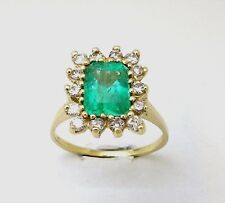 Ladies 14k yellow gold Colombian Emerald cut Emerald with diamond around ring