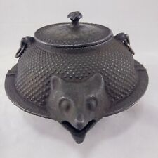 JAPANESE ASH TRAY, CAST IRON, IN FORM OF CHAGAMA, WITH TANUKI HEAD, TAIL, LEGS.