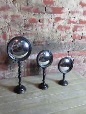 Glace / miroir (le lot) dit oeil de sorcière en bois sur pied noir patiné cuivré