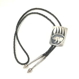 Steven Pooyouma Signed Native American Hopi Sterling Bear in Claw Bolo Tie