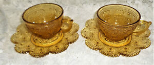 2 AMBER GLASS CUPS & SAUCERS~ORNATE PATTERN