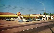 Photo. 1961-2. Lewiston, Idaho. Lou Bell Motors, Lincoln-Mercury auto dealership