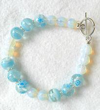 "Opalite + 10mm blue millifiori beads, 7.5"" bracelet"