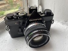 Black Olympus OM-1n 35mm SLR Film Camera with Zuiko 50mm f/1.8 Lens