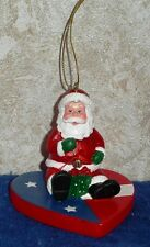 "AMERICANA CHRISTMAS SANTA CLAUS Sitting On a Heart 2.75"" Tall Hanging Ornament"