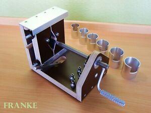 Federwinder  Neu   Clock mainspring winder.