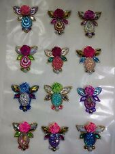 Handcrafted bling clusters and body jewels for face painting and festival makeup