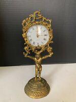 Vintage Hollywood Regency Globe Clock Gold Tone Ornate Child Base Germany