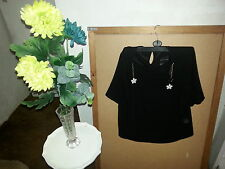 Woman black short sleeve top with trinket small size.